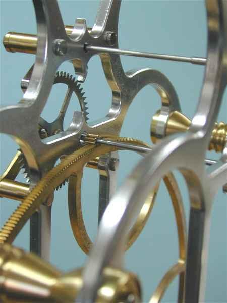 Three wheel skeleton clock